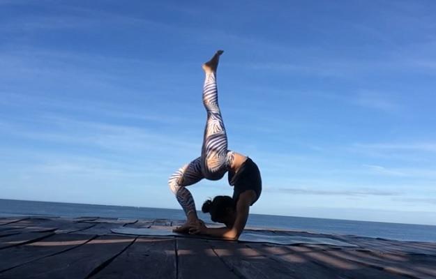 One-legged inverted staff pose