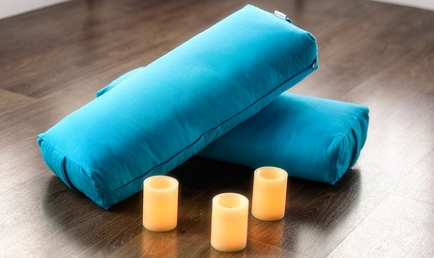 How to use a yoga bolster to challenge your practice