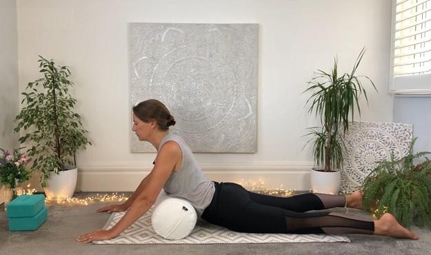 Yin yoga with bolster